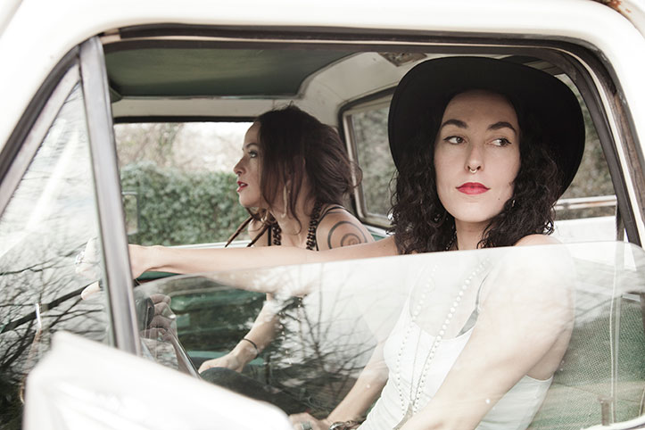 Picture of Leah Song and Chloe Smith in a pickup truck
